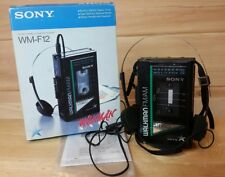 Sony Walkman WM-F12 Working with Box, Headphones, and Papers