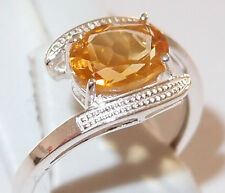 Oval Citrine twist solitaire in rhodium plated Sterling Silver, 1.75ct. Size P.
