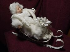 Sleeping Baby on sled Christmas Decoration  8 inches tall, 14 long, 4 1/4 wide