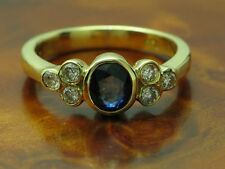 18kt 750 GOLD RING MIT 0,18ct BRILLANT & 0,40ct SAPHIR BESATZ / BRILLANTRING