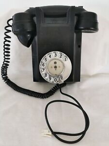 Vintage Ericsson mounted Wall Phone. Rotary dial with twisted cord.