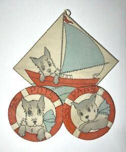Vintage S.S. Pots and Pans Dog Embroidered Potholders on Sailboat Rack Vogart