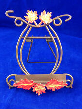 metal plate easel with orange autumn leaves brown picture display easel