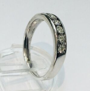 9ct White Gold Diamond Half Eternity Ring. 7 Channel Set Stones- 0.30ct. Size N