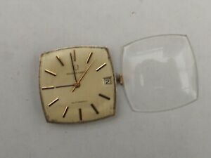a universal geneve automatic 28 jewel 69 cal microtor movement and crystal -