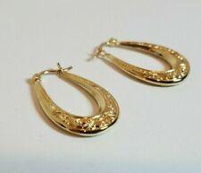 """14k Yellow Gold  1"""" Scroll-work Design Oval Hoop Earrings"""