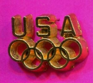 1984 OLYMPIC NOC USA GOLD PIN THICK USA GOLD OVER GOLD RINGS PIN