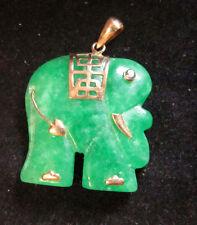VINTAGE 14K YELLOW GOLD JADE ELEPHANT WITH A MYSTIC TOPAZ EYE PENDANT