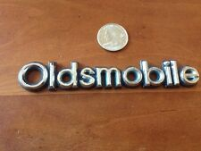 "Oldsmobile emblem logo badge 5-1/4 X 7/8"" Very Good Used Condition"