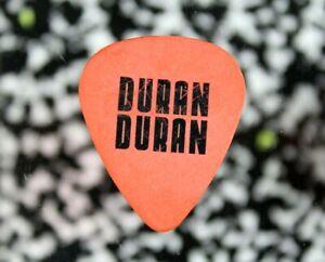 DURAN DURAN // John Taylor 2004 Astronaut Concert Tour Guitar Pick // Orange/Blk