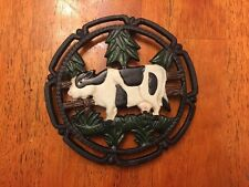 TRIVET ROUND  SHAPED WITH COW DESIGN CAST IRON