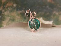 copper wire wrapped pendant one of a kind glass pendant. blue transparent glass