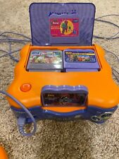 V Tech V Smile Kids Console w/8 games and a controller.