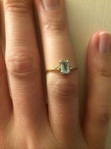 Emerald cut aquamarine and diamond accent ring yellow gold