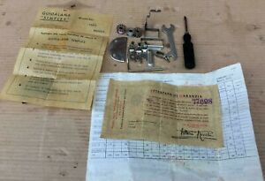 Vintage Necchi sewing machine Accessories and paperwork