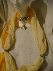 jewelled scarf in shades of yellow with silver heart