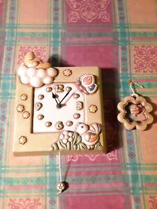 Orologio a parete con carillon e quadrifoglio della THUN