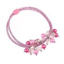 Accessori rosa elastici per l'acconciatura dei capelli