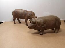 Set of 2 slightly different brown cast iron pig sculptures,figurines