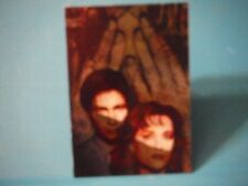 "X-Files card, Etched Foil, i1 ""Do Not Open Until X-Mas"", artist Miran Kim"