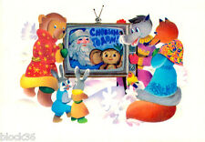 1977 Russian NEW YEAR postcard Animals watch TV show with Santa and Cheburashka