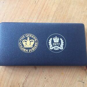 Ltd Edition Queen Elizabeth II silver and Golden jubilee Medallion set Cased .