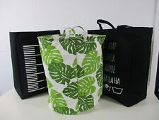 3 Laundry Bags, 2 Black 1 Leaf Pattern, Wipe Clean. Round and Bag Shape with han