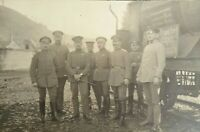 WW1  Real Photo postcard group of soldiers next to old lorry