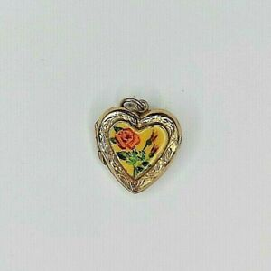 Vintage 9ct yellow gold back and front heart shaped locket with enamel flowers.