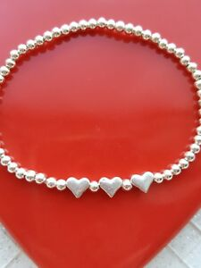 Womens silver plated ball bead stretchy stacking bracelet with three heart charm
