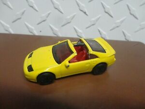 Loose Hot Wheels Yellow Nissan 300ZX w/Real Riders