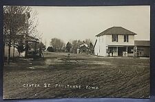c1910 real photo postcard....FRUITLAND IOWA...CENTER ST...OLD STORES? GAS PUMP??