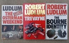 3 ROBERT LUDLUM PAPERBACK NOVELS.