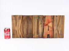 KODAK LTD SIGN, WOODEN, ABOUT 10 INCHES TALL MARKED HARRILD & SON/cks/214399