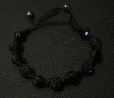 Great costume bracelet with black string and faceted black beads 3.5ins wide