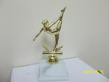 "Female Gymnastics award trophy, comes with engraving, female on base 7.25"" high"