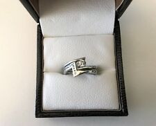Platinum Ring Set with Solitaire Diamond on a twist, Size I.