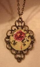 Delightful Looped Rim Brasstone Purple & Pink Showy Flower Pendant Necklace