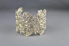 "shiny gold tone metal cuff bracelet 1 7/8"" wide cut out scroll filigree pattern"