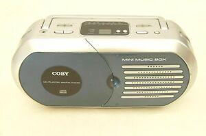 COBY mini music box cd player/AM/FM radio model CX-CD232 blue and silver