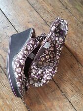 "Rocket Dog shoes.S.6. Brown w' floral pattern 3.5"" wedge heel. Adjustable strap."
