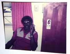 FOUND COLOR PHOTO BLACK AFRICAN WEDDING DAY MAN SMOKING IN 70'S THREADS GLASSES