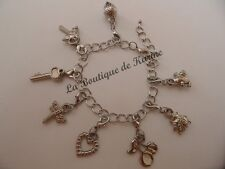 BRACELET AVEC 8 CHARMS BRELOQUE FERMOIR MOUSQUETON METAL ARGENTE CREATION BIJOUX