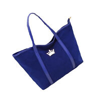 Celebrity designer large faux leather tote bag with crown design on front.