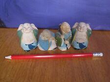 4 miniature Buddha figurines 4 spiritual