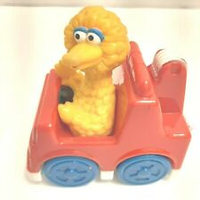 Big Bird drives his car