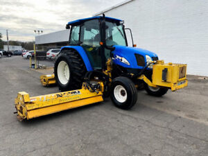 2000 New Holland TL100a Tractor with Mower Attachments