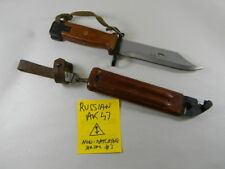 RUSSIAN RED BAKELITE  BAYONET WITH SCABBARD MARKED WITH ARROW IN TRIANGLE