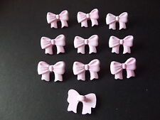 10 x PINK BOW SHAPED BUTTONS size approx 16mm x 10mm ~ BABY/CRAFT