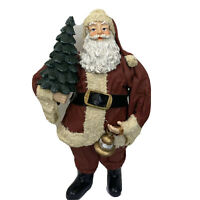 "Santa Clothique and Resin Holding Christmas Tree and Handbell 10"" Tall"